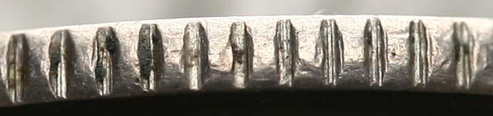 Fragment obrzeża oryginalnej monety gdańskiej 1/2 i 1 gulden 1923
